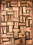 Irregularly shaped brown wooden blocks background Stock Images