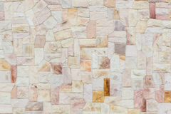 Irregularly stones wall surface. Gray background of modern style decorative irregularly stone wall surface Royalty Free Stock Photos