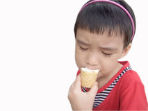 Irresistable. Child indulging in ice cream completely Stock Image