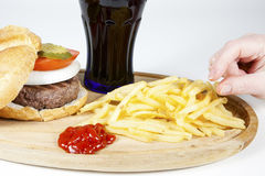 Irresistible burger with fries Stock Images
