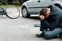 Irresponsible car driver after dangerous incident on the road wi. Th cyclist stock photos