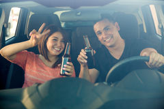 Irresponsible couple in a car Royalty Free Stock Photo