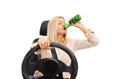 Irresponsible woman drinking and driving Royalty Free Stock Photo