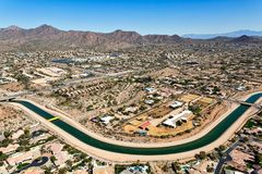 Irrigating the desert Southwest. Aerial view of the Arizona Canal irrigating the desert southwest as it winds it's way through a Scottsdale suburb stock photography