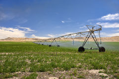 Irrigating a farm field. Royalty Free Stock Image