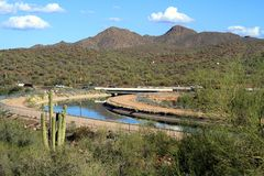 USA, Arizona: Road Crossing Irrigation Canal  Royalty Free Stock Image