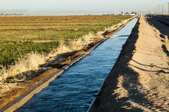 Irrigation canal. Water flowing in an irrigation canal in Arizona Stock Photos