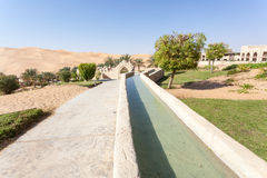 Irrigation canal in a desert resort Royalty Free Stock Images