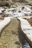 Irrigation channel. With water flowing through Stock Photography
