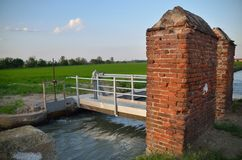 Irrigation channel near the rice fields royalty free stock photo