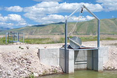Irrigation Dike Flood Control Gate in Bear Valley River Wildlife Refuge, Idaho.  Horizontal.  Also known as Dingle Marsh or Swamp Stock Photos