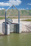 Irrigation Dike Flood Control Gate in Bear Valley River Wildlife Refuge, Idaho.  Vertical.  Also known as Dingle Marsh or Swamp Royalty Free Stock Image
