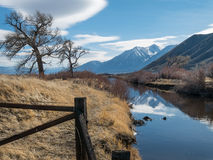 Irrigation ditch in the Carson River Valley. Irrigation ditch and the Carson Range, Carson Valley, Nevada Stock Image