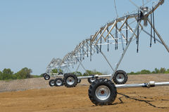 Irrigation. Equipment awaits the emergence of new plants in a rural farm field stock photography