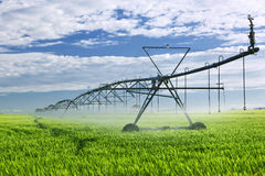 Irrigation equipment on farm field Stock Photos