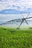 Irrigation equipment on farm field. Industrial irrigation equipment on farm field in Saskatchewan, Canada Stock Photo
