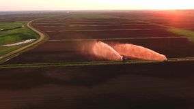 Aerial view:Irrigation system watering a farm field. Stock Photos