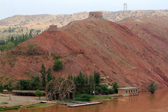 Irrigation facilities and Wall of China on the Yellow River shor Royalty Free Stock Photos