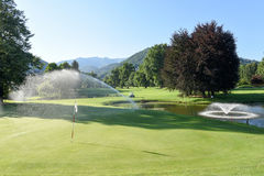 Irrigation of the golf course at Magliaso Stock Photos