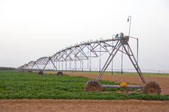 Irrigation Machine. A Lateral move, center pivot with drop sprinklers, irrigation machine stock photography