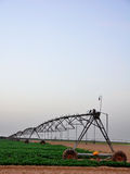 Irrigation Machine. A Lateral move, center pivot with drop sprinklers, irrigation machine royalty free stock images