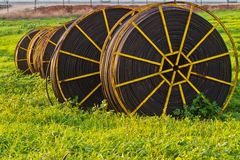 Irrigation pipes. Drip irrigation pipes wating to be used in the field Stock Photography