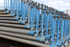 Irrigation pipes, blue colored ends, stacked on each other. For storage royalty free stock photo