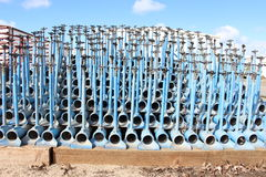 Irrigation pipes, blue colored, stacked on each other, blue sky. Background stock images