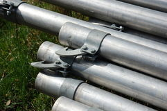 Irrigation pipes piled together waiting for the summer season to begin Stock Photo
