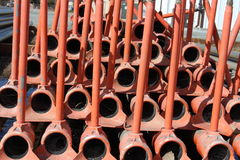 Irrigation pipes, red, stacked, for storage. Irrigation pipes, red, stacked on each other, for storage stock image