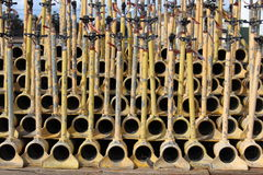 Irrigation pipes, yellow, stacked on each other for storage. Against a blue sky background royalty free stock image