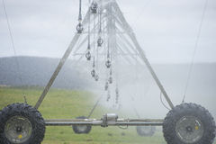 Irrigation by Pivot spraying fertilizer on farm Stock Photo