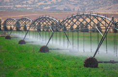 An irrigation pivot watering Royalty Free Stock Images