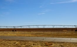 An irrigation pivot watering a field royalty free stock image