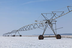 Irrigation pivot in winter. Image of an irrigation pivot in a field covered by snow in winter Royalty Free Stock Images