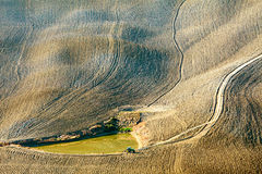 Irrigation pond. With tractor in dry land down the hill Stock Images