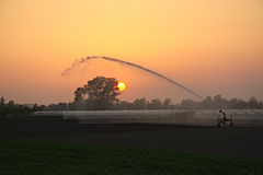 Sunset  viewing. Irrigation at sunset.country life Stock Image