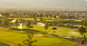 Irrigation Sprinklers in a Desert Golf Course Royalty Free Stock Images