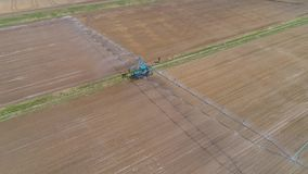 Irrigation system on agricultural land. Aerial view of Crop Irrigation using the center pivot sprinkler system. An irrigation pivot watering agricultural land stock footage