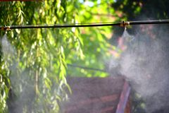 Irrigation system close-up. Humidification of air by steam on the street outdoor in a hot summer day morning Stock Photo