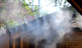 Irrigation system close-up. Humidification of air by steam on the street outdoor in a hot summer day morning Royalty Free Stock Images