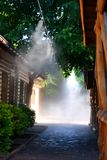 Irrigation system close-up. Humidification of air by steam on the street outdoor in a hot summer day morning Stock Images
