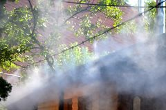 Irrigation system close-up. Humidification of air by steam on the street outdoor in a hot summer day morning Stock Photography