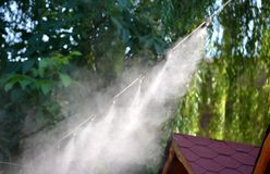 Irrigation system close-up. Humidification of air by steam on the street outdoor in a hot summer day morning Stock Image