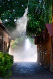 Irrigation system close-up. Humidification of air by steam on the street outdoor in a hot summer day morning Stock Photos