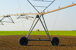 Irrigation system and combine harvesting green peas Stock Photos