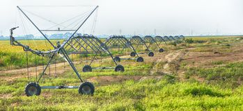 Irrigation system over long distances. Long-range irrigation system used in the Braila area, This type of irrigation is by drop and can be used on large areas stock photo