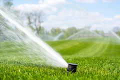 Irrigation system sprinkles water fountain for long distance royalty free stock photography