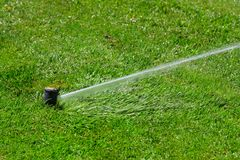 Irrigation system throwing water stock photos