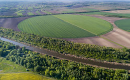 Irrigation system in wheat field. Aerial view of irrigation center pivot system on round shaped wheat field in springtime shoot from drone Stock Photo